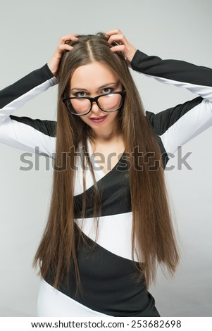 Portrait of a young angry flushed woman screaming - stock photo