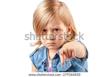 Portrait of a young angry girl pointing up - stock photo