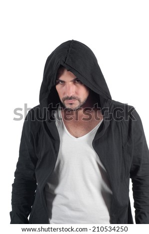 Portrait of a young angry male in the hood - stock photo