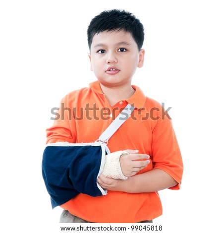 Portrait of a young Asian boy with broken arm in plaster cast, isolated on white background. - stock photo