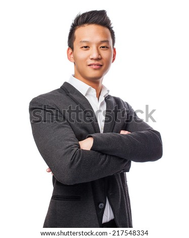 portrait of a young asian business man crossing his arms - stock photo