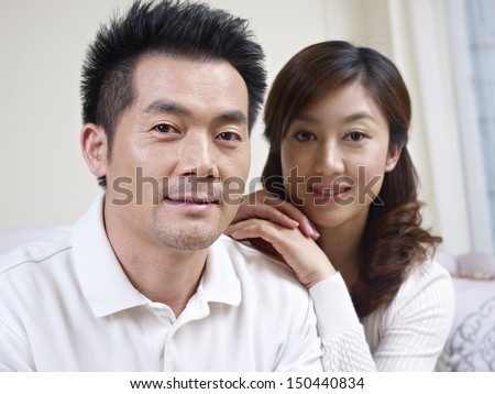 portrait of a young asian couple, focus on the man.