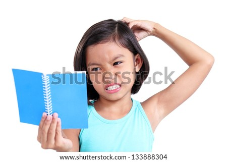 Portrait of a young asian girl scratching her head while having difficulty reading. - stock photo