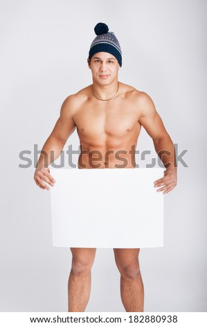 Portrait of a young athlethic man holding a blank board for text - stock photo