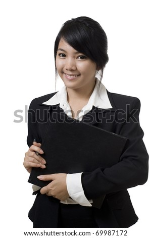 Portrait of a young attractive Asian business woman - stock photo