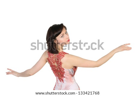 Portrait of a young  attractive girl with raised open hands on white background. Place for text design. - stock photo