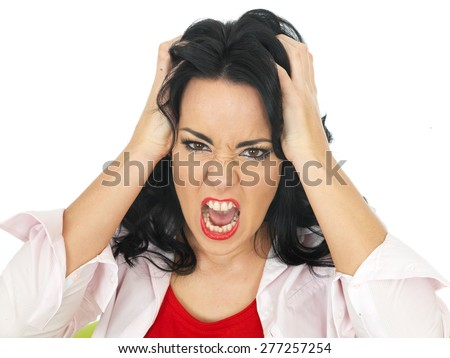 Portrait of a Young Attractive Hispanic Woman Holding Her Hair Screaming in Frustration and Anger - stock photo