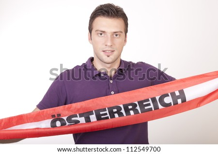 Portrait of a young attractive male austria fan. - stock photo