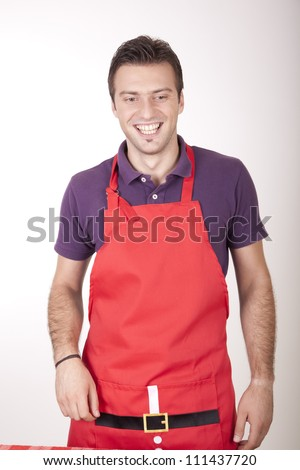 Portrait of a young attractive male cook smiling. - stock photo