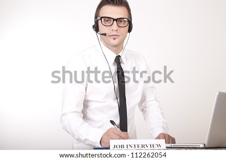 Portrait of a young attractive male receptionist with a sign job interview. - stock photo