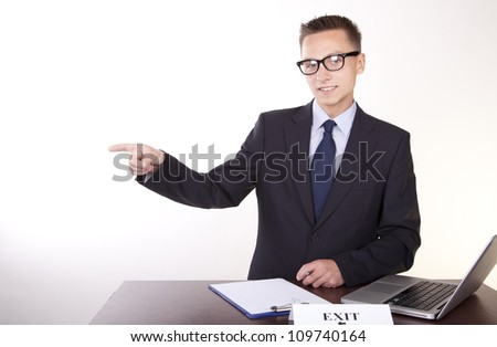 Portrait of a young attractive male secretary with a sign exit. - stock photo