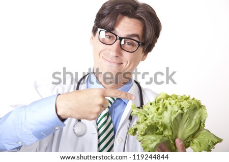Portrait of a young attractive man doctor holding green salad.