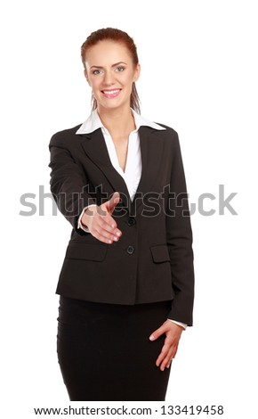 Portrait of a young attractive woman giving her hand - stock photo