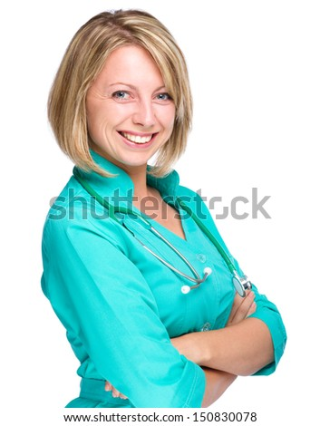 Portrait of a young attractive woman wearing doctor uniform and crossing her arms, isolated over white - stock photo
