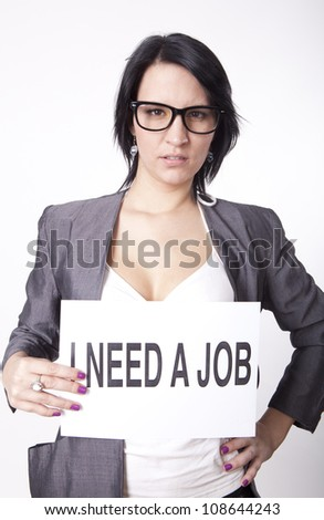 Portrait of a young attractive woman with a sign need work.