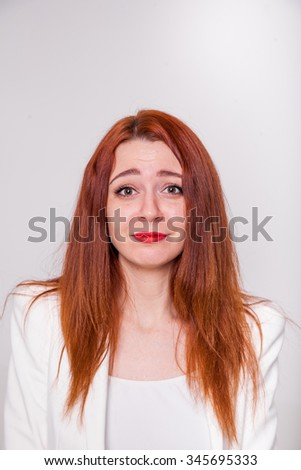 Portrait of a young attractive woman with red hair, on white