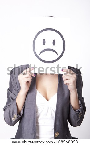 Portrait of a young attractive woman with sad smiley sign. - stock photo