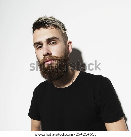 Portrait of a young bearded man on a white background