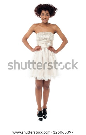 Portrait of a young beautiful African American woman with hands on waist.