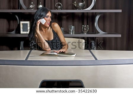 Portrait of a young beautiful business woman in luxury office, talk to phone