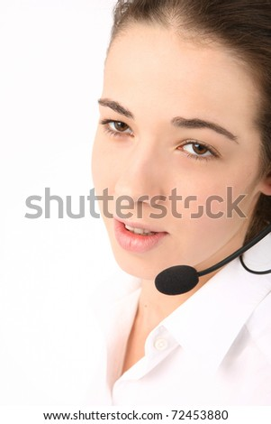 portrait of a young beautiful business woman using head phone