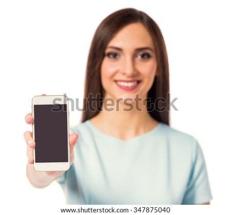Portrait of a young beautiful business woman using the phone isolated on a white background - stock photo
