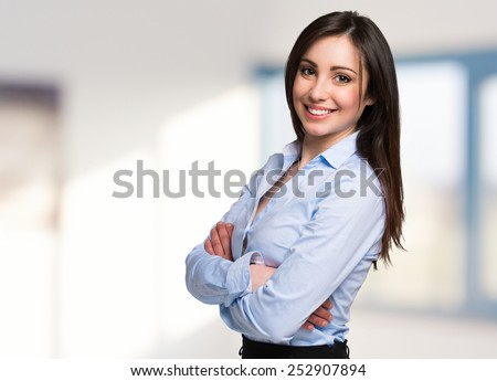 Portrait of a young beautiful businesswoman, Bright blurred background - stock photo