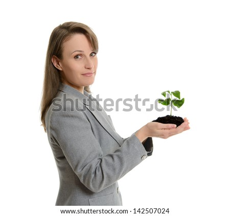 Portrait of a young beautiful businesswoman in office clothes holding