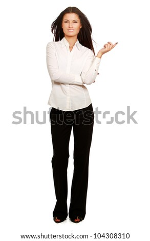 Portrait of a young beautiful businesswoman pointing something, isolated on white background - stock photo
