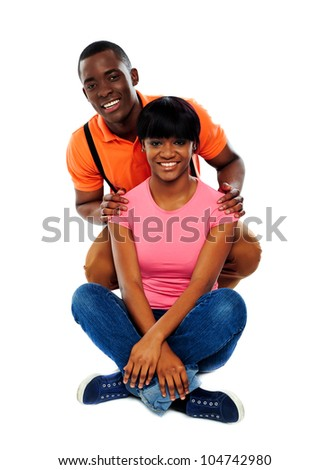 Portrait of a young beautiful couple in studio isolated on white - stock photo