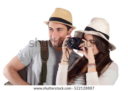 Portrait of a young beautiful couple on a trip. Travel concept. Isolated white background.