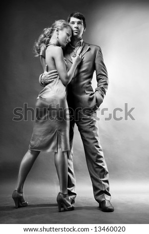 Portrait of a young beautiful couple. Young woman embraces man. - stock photo