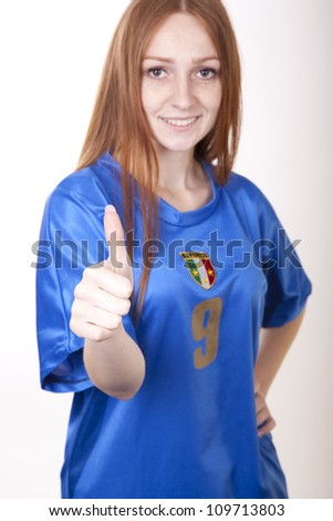 Portrait of a young beautiful female italy fan.