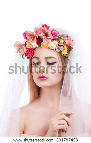 Portrait of a young beautiful girl. bride in veil. Girl with a veil on his face and flowers in her hair - stock photo