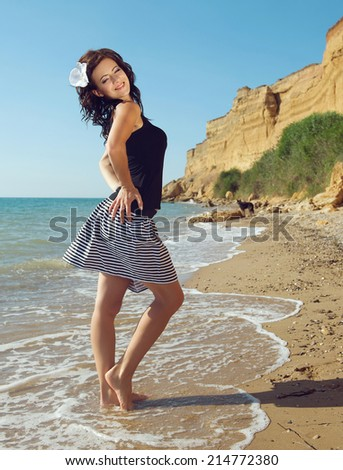 Portrait of a young beautiful girl on the beach. Summertime  - stock photo