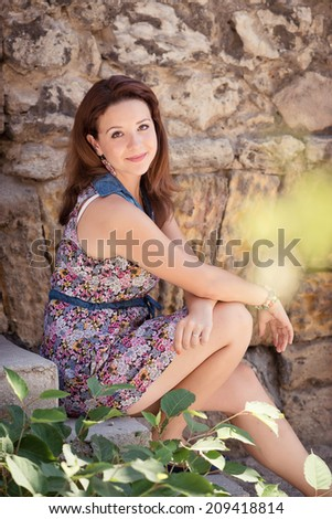 Portrait of a young beautiful girl outdoors