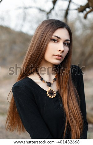 Portrait of a young beautiful girl with the necklace.