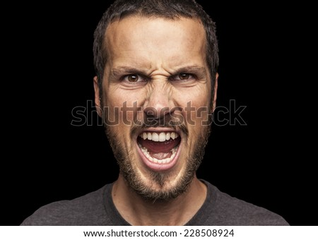 portrait of a young beautiful man screaming - stock photo