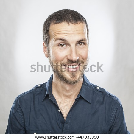 portrait of a young beautiful man smiling, face expression - stock photo