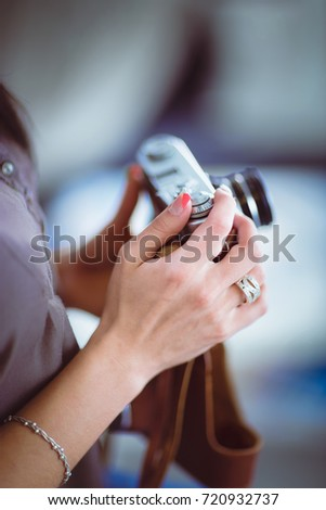 Portrait of a young beautiful photographer woman near table