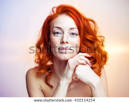 Portrait of a young beautiful redhead woman, no makeup - stock photo