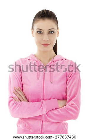 Portrait of a young beautiful smiling woman in pink tracksuit, isolated on white.