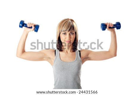 Portrait of a young beautiful sportswoman exercising with dumbbells