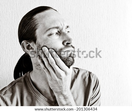 Portrait of a young beautiful thinking man. Black and white image