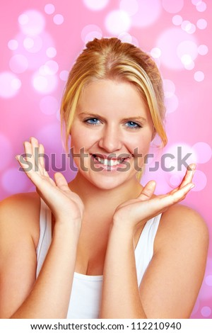 portrait of a young beautiful woman against glossy background - stock photo
