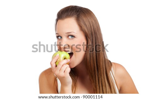 Portrait of a young beautiful woman eating an apple, isolated on white