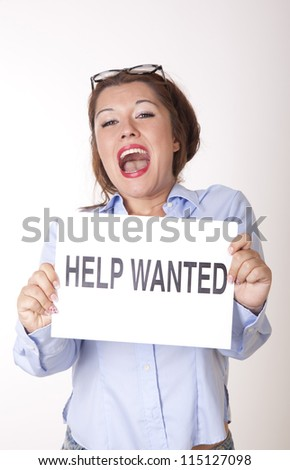 Portrait of a young beautiful woman holding a sign help wanted.