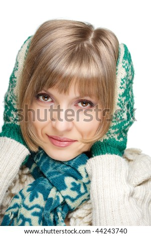 Portrait of a young beautiful woman in mittens and scarf, isolated on white - stock photo