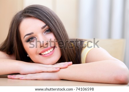 Portrait of a young beautiful woman resting - stock photo