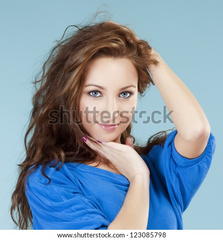 portrait of a young beautiful woman with brown hair and blue eyes - stock photo
